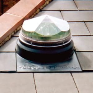 Pitched slate roof sun tube